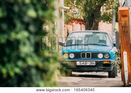Tbilisi, Georgia - October 21, 2016: Old damaged rusty sedan car BMW 3 Series, E30, parking on street. The BMW E30 is an entry-level luxury car which was produced by BMW from 1982 to 1994.