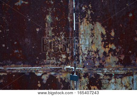 Rusty Metal Gate With Lock