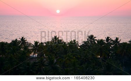 rustic pink tropical sunrise on a ocean in Asia.