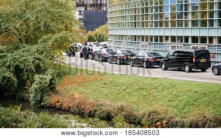STRASBOURG FRANCE - OCT 7 2015: Row of official executive luxury government and embassy cars at the rear door of European Parliament building in France during President Francois Hollande visit in Strasbourg