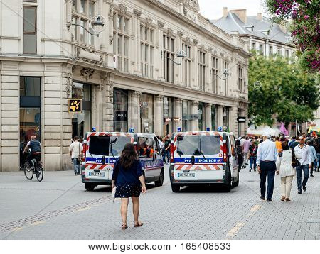 STRASBOURG FRANCE - SEP 12 2015: Police van surveillance of large group of Kurdish community wave flags and banners of convicted Kurdistan Worker's Party (PKK) leader Abdullah Ocalan during a demonstration calling for Ocalan's release in Strasbourg