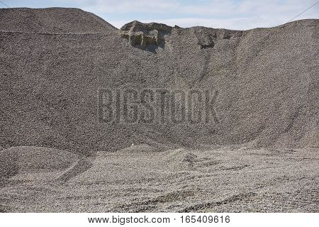 Big gravel pile in a quarry. Shingle.