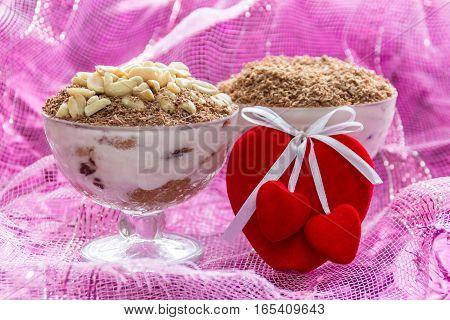 Dessert tiramisu (cheese dessert) in bowls to Valentine's day