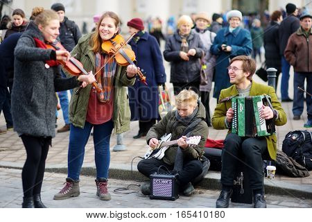Vilnius, Lithuania - March 4, 2016: Young Street Musicians Performing At Easter Fair In Vilnius, Lit