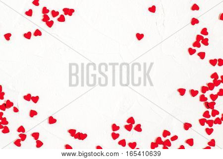 Elegant festive background with sugar decorations in the form of heart on white textured surface with space for text. The mood of tenderness and love. Symbols of Valentines Day