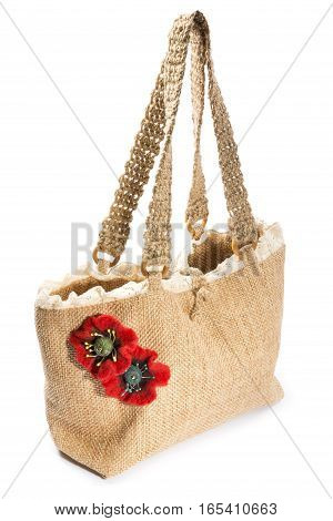 Two brooches from felted wool in the form of a poppy on a woman's bag
