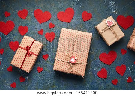 Valentines day background with hearts and a gift boxes on concrete board. Flat lay. Top view table. Packing presents for valentine day, birthday, mother's day or christmas.
