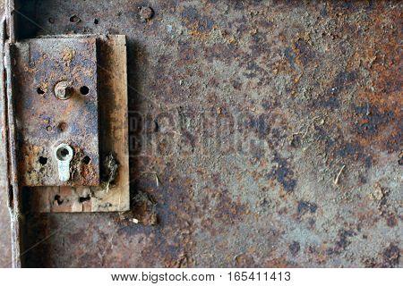 texture of rusty metal door with broken door lock