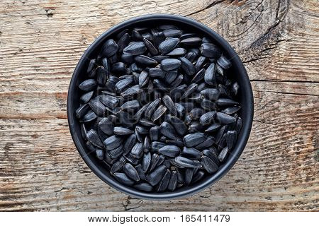 Bowl Of Black Sunflower Seeds From Above