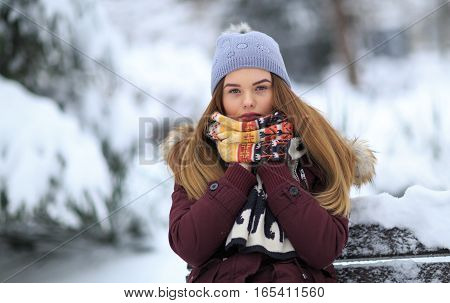 Winter portrait of a woman. One young woman only