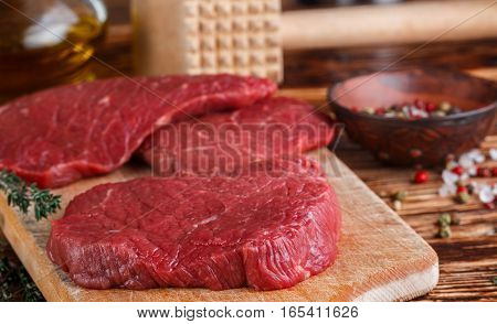 Fresh Meat. Raw Beef Chops On A Cutting Board Ready To Prepare A Delicious Dinner. Selective Focus