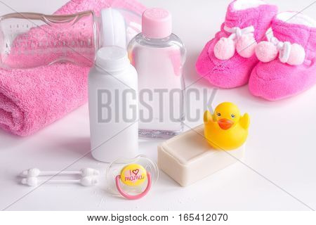 baby organic cosmetics for bath on white bakground close up