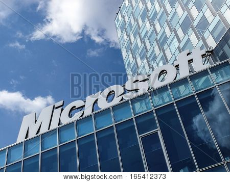 Bucharest Romania March 26 2016: Microsoft corporation office building facade with logo in Bucharest Romania. Microsoft Corporation is an American multinational technology company that develops and sells computer software and consumer electronics.