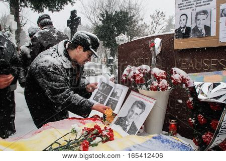 Bucharest Romania January 26 2014: People gathered at the grave of Romania's late communist dictator Nicolae Ceausescu to commemorate his birthday. Year after year Romania's nostalgic Communists gather to mourn Ceausescu who was executed on Christmas Day