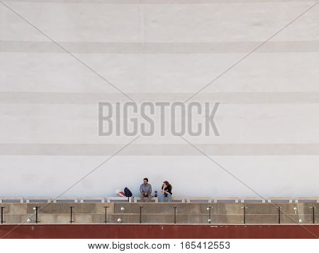 Bucharest Romania March 30 2016: Two men are smoking in an outdoor smoking area of the National Theater in Bucharest.