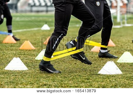 The Feet Of Paok Players And Football Training Equipment