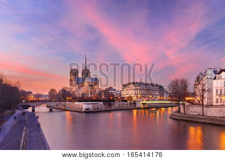 Picturesque grandiose sunset over Ile de la Cite, Seine River and Cathedral of Notre Dame de Paris, France