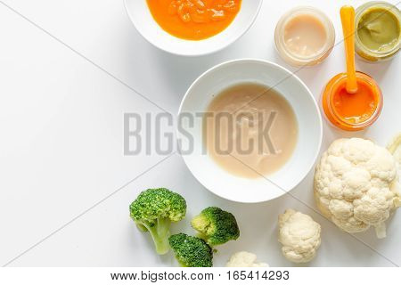 cooking vegetable purees for baby on white background top view.