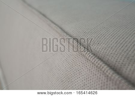 Grey colored mattress of bed in bedroom represented on hotel room. Mattress of bed in bedroom. Texture of mattress with no pattern and pictures.