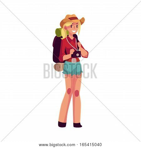 Young pretty girl travelling, hitchhiking with backpack and camera, cartoon illustration isolated on white background. Female backpacker, hitchhiker in cowboy hat and shorts with backpack and camera