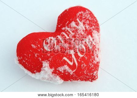 Red heart on the snow. Beautiful background on Valentines Day