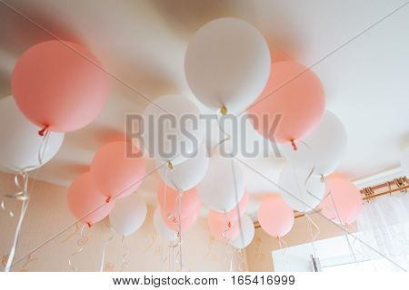 Colorful balloons in room prepared for birthday party.