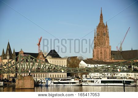FRANKFURT, GERMANY - JANUARY 05: The view over the Old Town in Frankfurt with the Iron Bridge as well as the Imperial Cathedral of Saint Bartholomew on January 05, 2017 in Frankfurt.