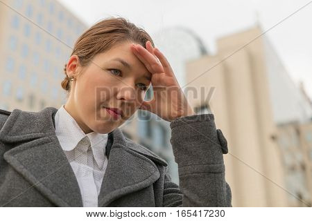 Depressed Business Woman On The City Street