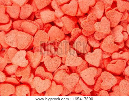 Candy heart confetti as background. Copy space. Top view or flat lay. Close up