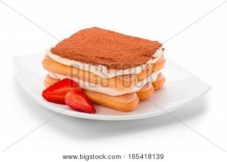 Tiramisu with strawberry on plate isolated. Clipping path