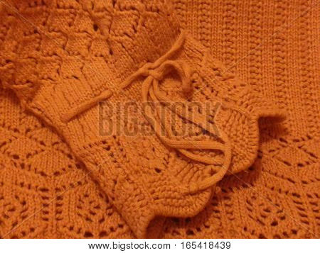 Knitting - a method of manufacturing a cloth or a separate product by creating loops that intertwine