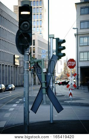 A crossroad in the city center of Frankfurt with various traffic signs.