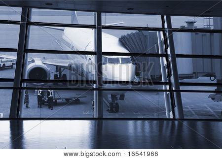 a passenger waiting for the flight at airport in shanghai china.