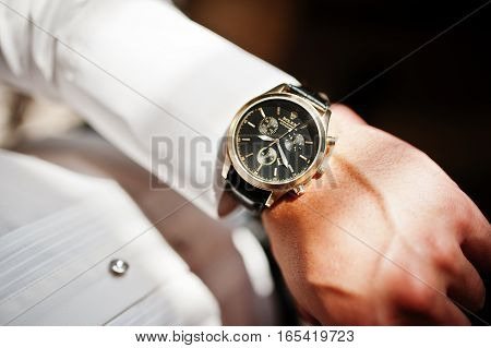 Hai, Ukraine - January 5, 2017: Man Looking On Luxury Watches Rolex On His Hand.
