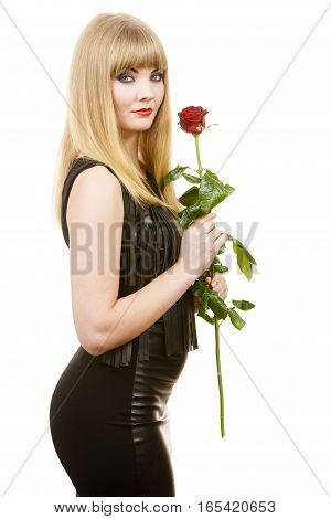 Woman holding rose flower. Attractive blonde lady dark makeup evening black dress studio shot isolated on white. Beauty dating celebration concept