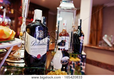 Hai, Ukraine - January 5, 2017: Different Bottles On Bar Reception With Ballantines In The Center.