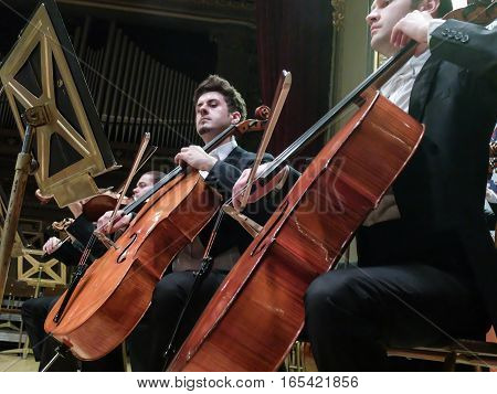Bucharest Romania March 9 2016: Musicians are playing on cellos in a concert at Romanian Atheneum in Bucharest.