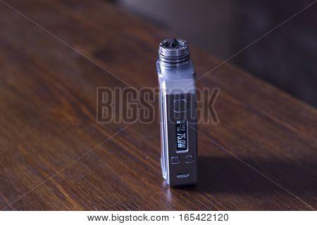 Modern electronic mech mod vaping device at the store