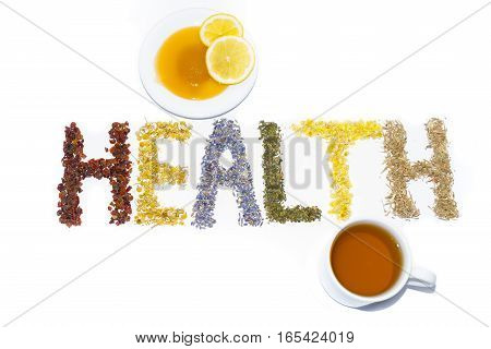 Word Health posted of dried herbs and flowers folk medicine of nature. Honey lemon slices a cup of tea. Treats force of nature. Cynosbati Matricaria chamomilla lavandulae Urtica Helichrysum arenarium AsteraceaePolygonum aviculare.