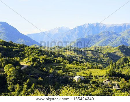 beautiful view on village in mountains, postcard from south, few houses