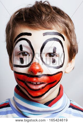 little cute boy with facepaint like clown, pantomimic expressions close up isolated