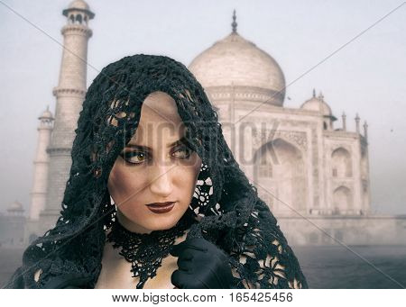 Pretty eastern woman in head shawl on Taj Mahal background photo. Background used: https://pixabay.com/en/taj-mahal-india-agra-tomb-grave-366/ Creative Commons 0 (CC0 Public Domain)