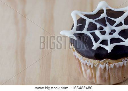 Cupcake with spider web, cupcake bathed in chocolate with spider web