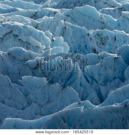 PLates of vertical ice emerge as the sun melts down glacial ice.