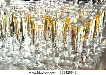 Neat Crystal glasses with golden expensive champagne