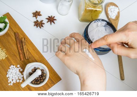 Young Woman Is Applying Homemade Cream On Her Skin. A Lot Of Ing