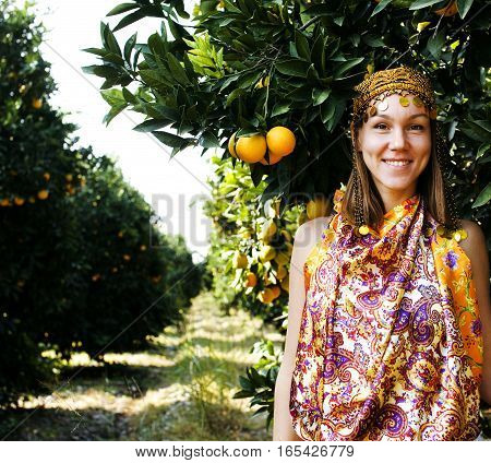 pretty islam woman in orange grove smiling, real muslim girl lifestyle
