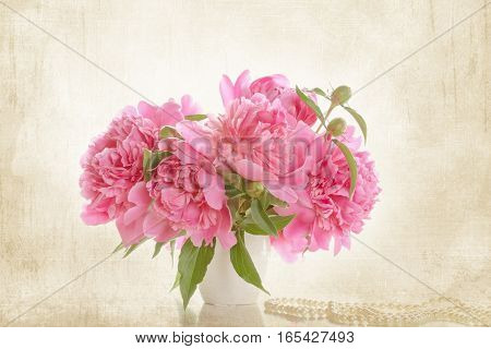 Vintage toning. Bouquet of pink peonies on a light background. Gift Valentine's Day.
