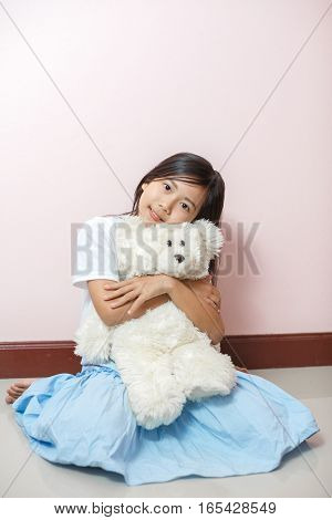 Child Little Girl Asian Thai Nationality With White Toy Teddy Bear Over Pink Wall Background.