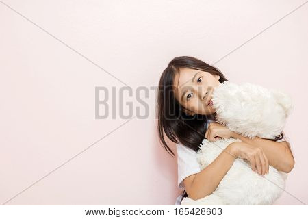 Child Little Girl Asian Thai Nationality With White Toy Teddy Bear Over Pink Wall Background And Loo